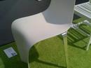 Stol i termoformet Corian® og rustfaste stålben. Udført i 12 mm Corian®. Farve: Glacier White.