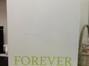 Corian® med indfræset motiv på bagside - uden lys. Farve: Glacier White og Grape Green.