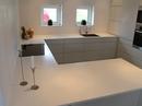 Dupont Corian køkken bordplade med underlimet granitvask.
