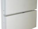 Opslået dobbelt klapseng som fylder mindre end 30 cm.