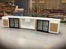 Barløsning med køleskabe, laminat låger og glas hylder, udført i Dupont Corian Antarctica.